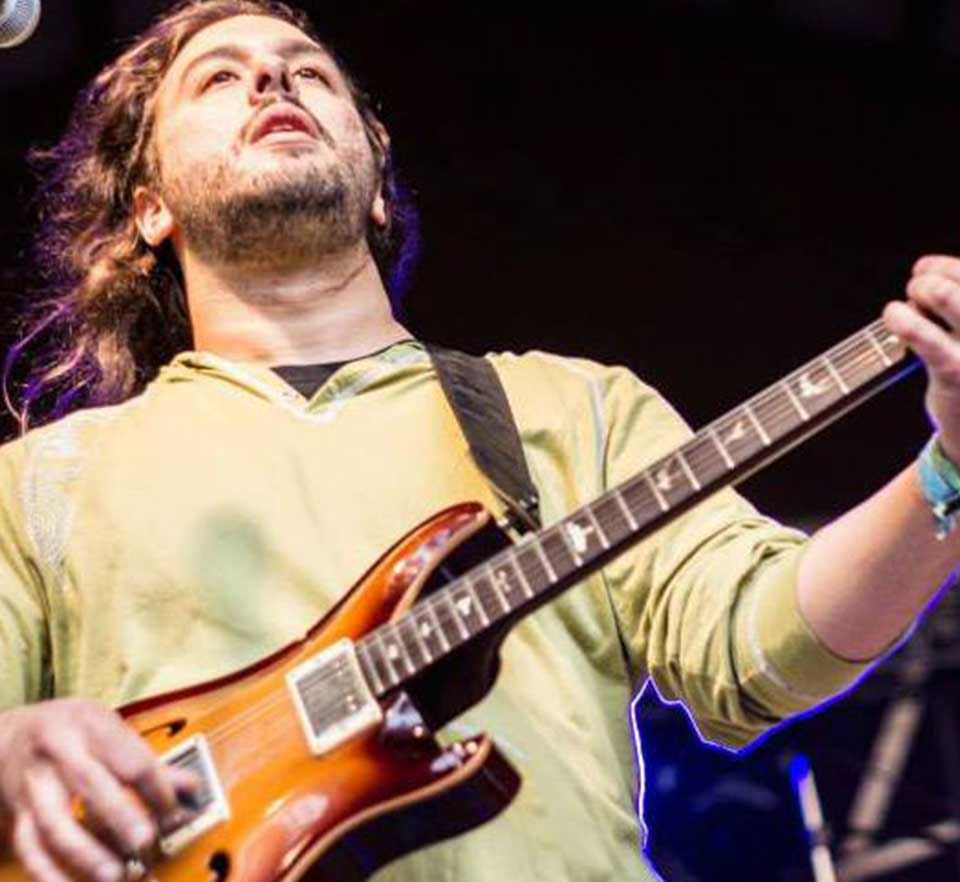 Image of Jordan Linit playing the guitar